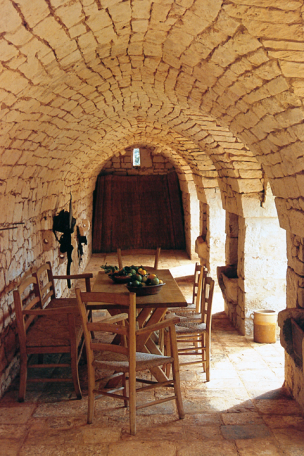 """rustic table & chairs under a low, vaulted brick ceiling from """"The Way We Live In the Country"""" by Stafford Cliff & Gilles de Chabaneix"""