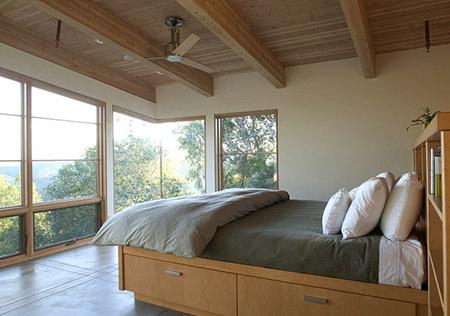 Wooden bed with storage beneath