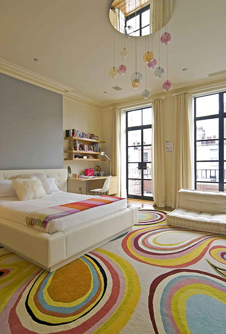 Child's bedroom with white double bed and colourful rug