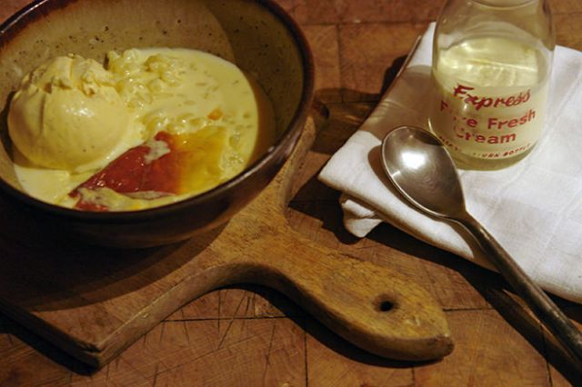 Bowl of cardamom rice pudding with vanilla ice cream and pouring cream | H is for Home