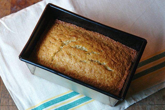 Cooked coconut loaf cake in its tin | H is for Home