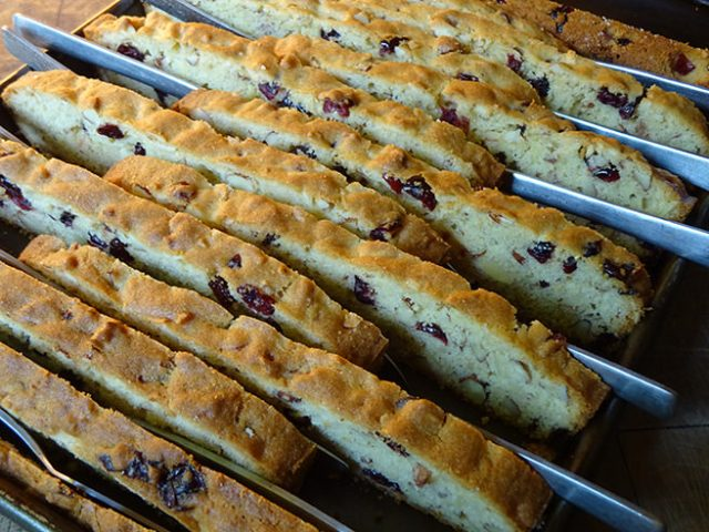 Knives between cranberry almond biscotti slices | H is for Home