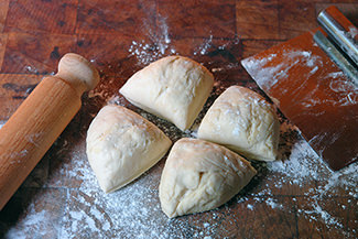 Flatbread dough divided into quarters | H is for Home