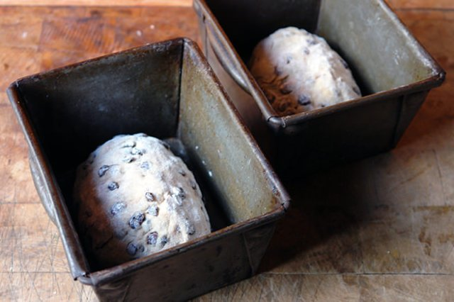 hot cross loaf dough in vintage tins