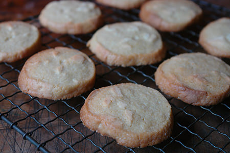 Cooked marzipan refrigerator cookies cooling on a wire rack