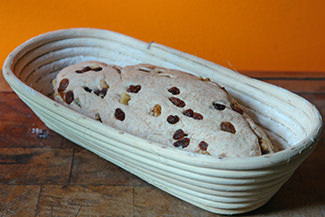 Home-made walnut and sultana loaf dough profing in a cane banneton | H is for Home