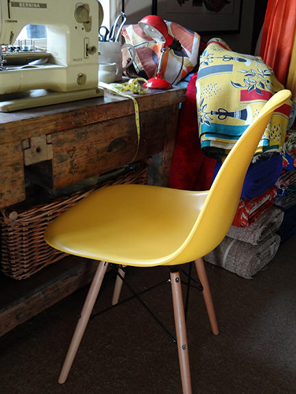 reproduction yellow DSW chair from Metro Furniture in our craft room