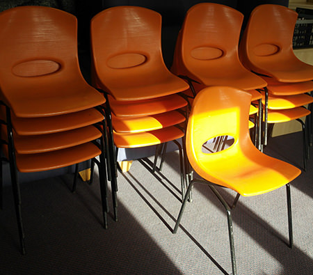 job lot of vintage orange stacking chairs for sale by & in support of Arch Stepping Stones Appeal on eBay for Charity