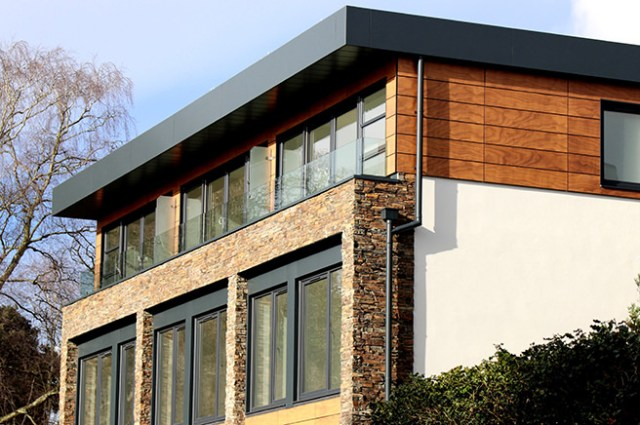 House with exterior brick and wood cladding