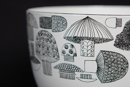detailed view of a large, vintage Finel enamel bowl decorated with mushroom pattern