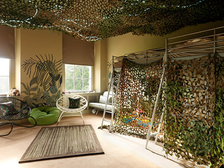 Boys' bedroom decorated with army green camouflaged bunk beds