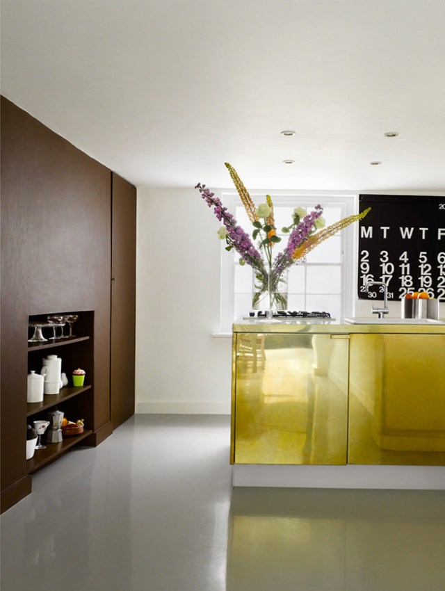 Brass-clad kitchen cabinet