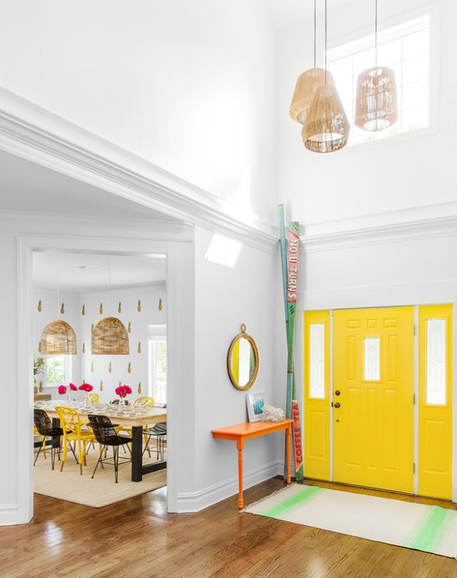 Bright entrance with daffodil yellow painted front door