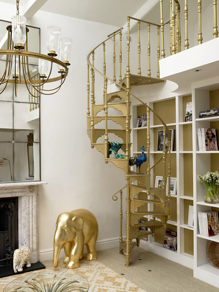 Mezzanine with gold painted spiral staircase, chandelier and elephant figure