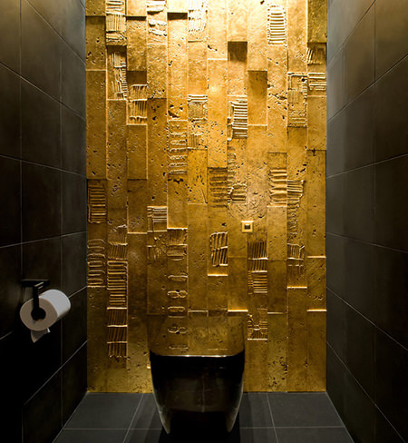 Gold tiled cloakroom