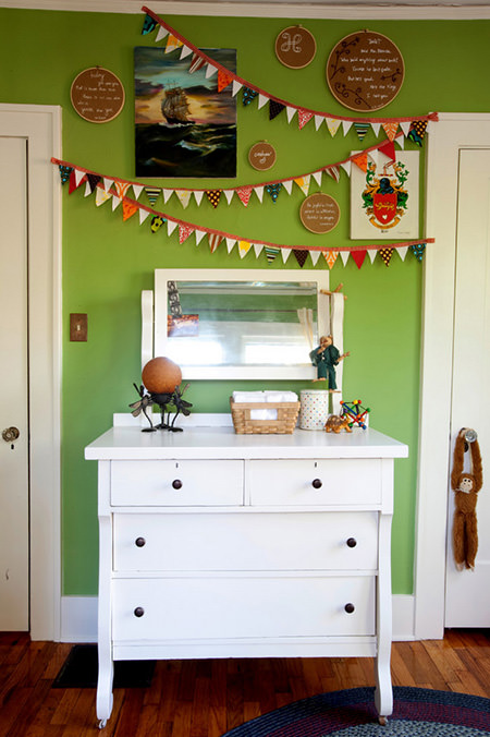 white chest of drawers in front of a green flash painted wall