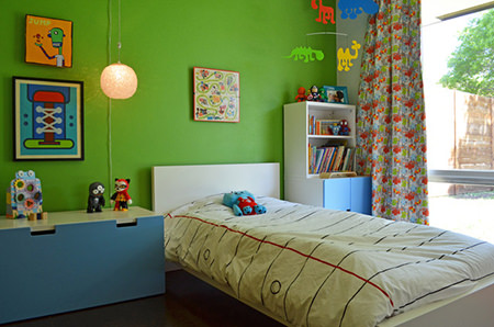 Kid's bedroom with green flash painted wall