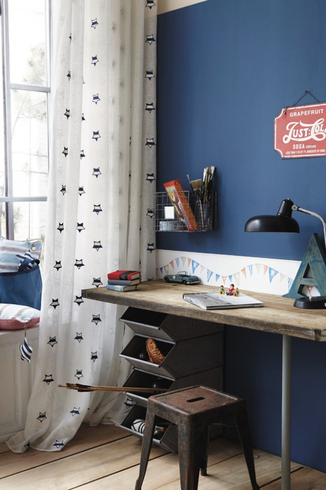 Industrial styled kid's room with indigo painted wall