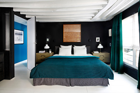 Black painted bedroom with petrol blue soft furnishings