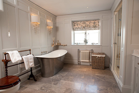 Bathroom with pewter clad slipper bath