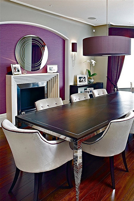 Dining room with purple painted wall, lampshades and curtains