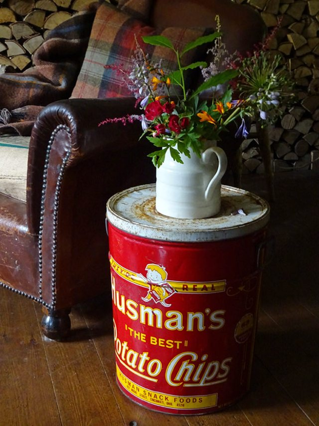 Vintage Husman's Potato Chips tin being used as a side table | H is for Home