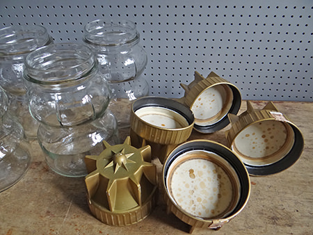 gold coloured lids of vintage Italian glass jars