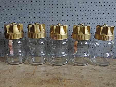 row of vintage Italian glass jars