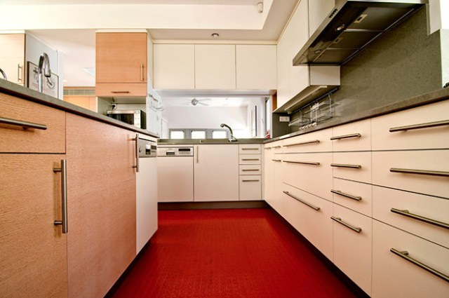 Kitchen with hard-wearing red rubber flooring
