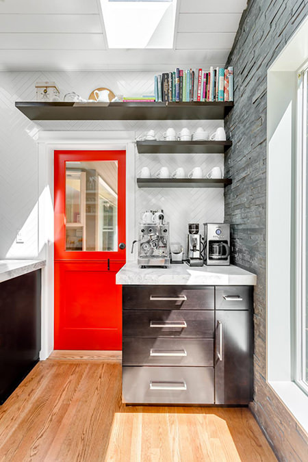 Fire engine red door leading out of a kitchen