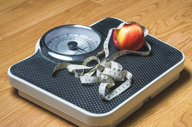 Bathroom scales and measuring tape