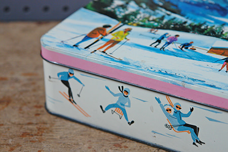 Detail from vintage biscuit tin with alpine illustrations