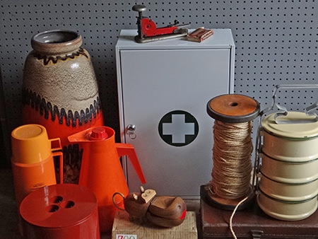 selection of vintage homewares coming to the H is for Home shop in mid January 2015 including a fat lava floor vase, two-tone orange Thermos vacuum flask, orange vacuum jug, maroon Crayonne ice bucket, white first aid tin, cream enamel tiffin, large bobbin with twine, industrial stapler and wooden Zoo-line hippo figure