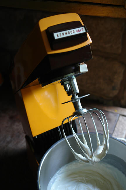 no churn rum & raisin ice cream being whipped in an orange vintage Kenwood mixer