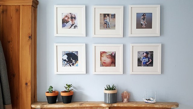 Gallery wall of photos in square white frames from Now Frame It