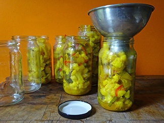 Filling jars with piccalilli | H is for Home