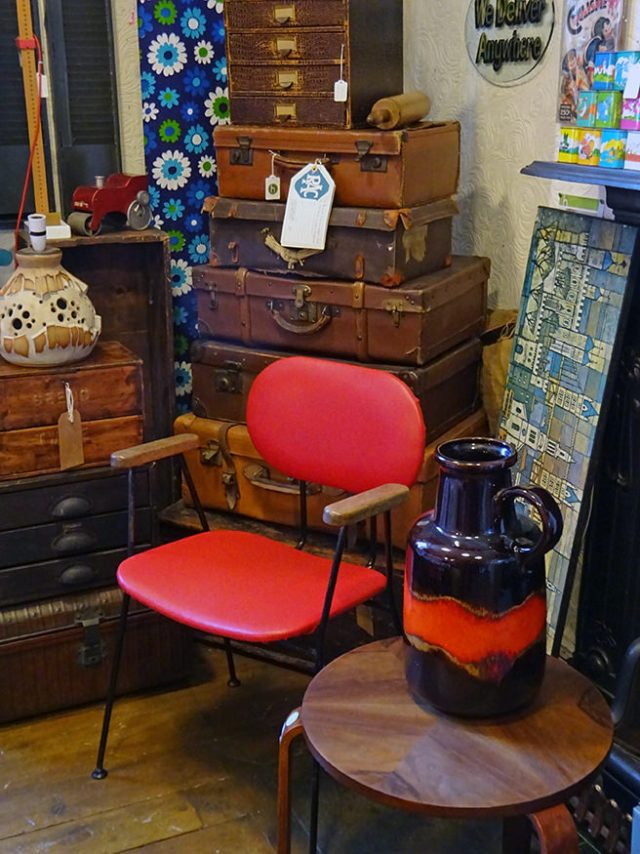 Stack of vintage leather luggage cases, midcentury modern desk chair and large West German vase | H is for Home