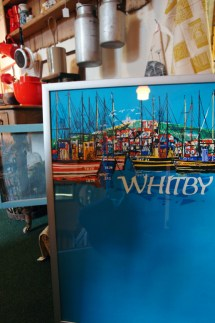 view of the H is for Home pitch in the antiques centre showing a framed vintage original 'Whitby' travel poster