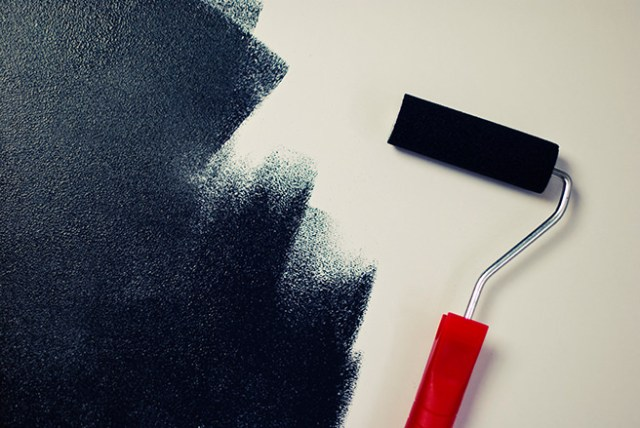 Painting a wall black with a roller
