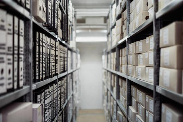 Labelled files on shelves in storage