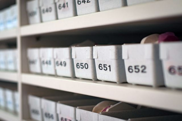 Shelves with numbered boxes