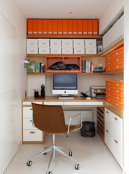 small home office with large collection of orange and white storage boxes