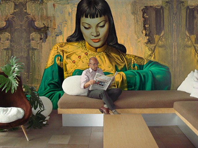 Wayne Hemingway in front of a huge mural of Tretchikoff's Lady from the Orient