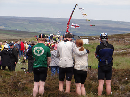 people in cycling gear at the Tour de Yorkshire in Cragg Vale