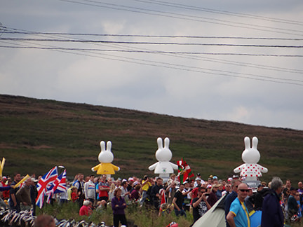 Giant Miffy figures atop cars at the Tour de Yorkshire in Cragg Vale