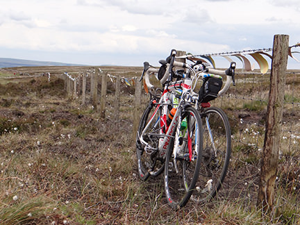 racing bikes against a fence in Cragg Vale