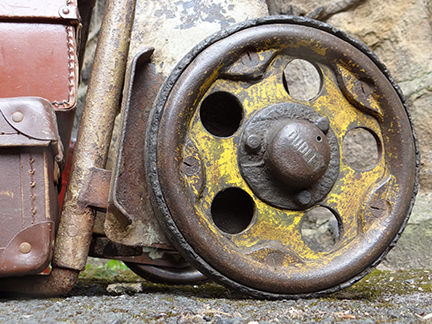 detailed view of vintage industrial trolley wheel