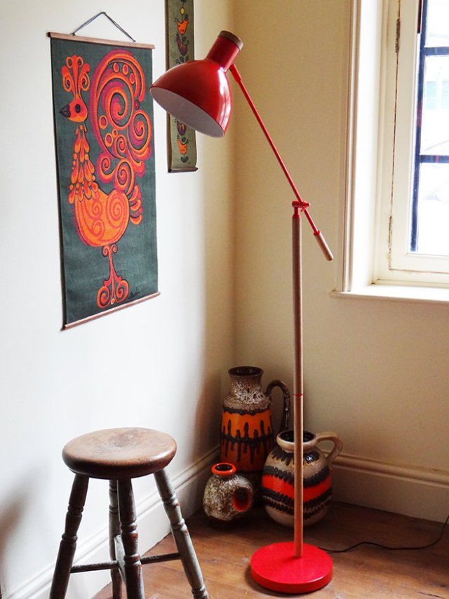 Red contemporary floor lamp with antique stool and vintage West German fat lava vases | H is for Home
