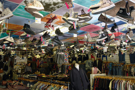 selection of vintage trainers hanging from the ceiling in Blue Rinse, Oldham Street, Manchester