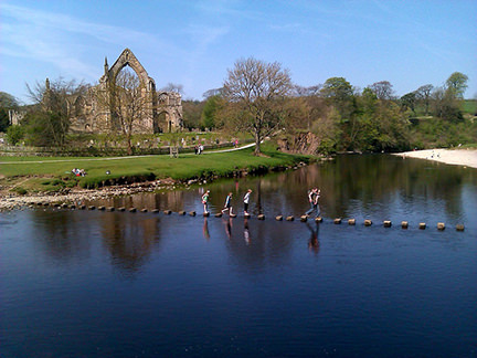 Stepping stones across the river at Bolton Abbey